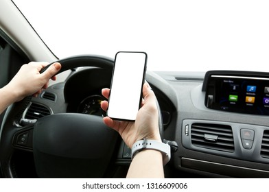 The young woman holding mobile phone with white screen sitting in her car