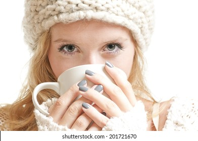 Young woman holding a mug and looking in to the camera . White background . Studio shot