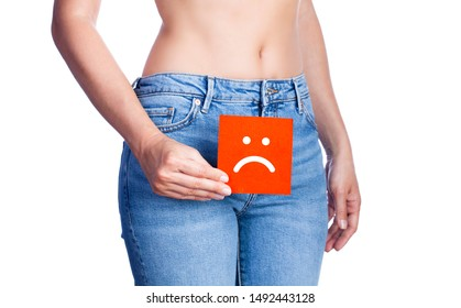 Young woman holding a paper with sad face on her waist. Vaginal or urinary infection and problems concept