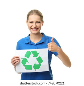Young woman holding paper sheet with recycling symbol on white background
