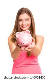 Young woman holding a piggy bank (money box) - savings concept