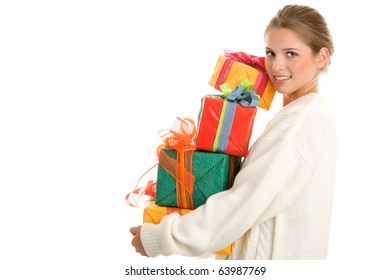 Young woman holding pile of gifts