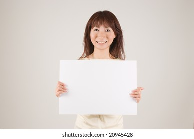 Young woman holding placard