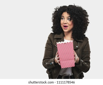 young woman holding popcorn