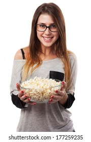 young woman holding a popcorn bowl isolated