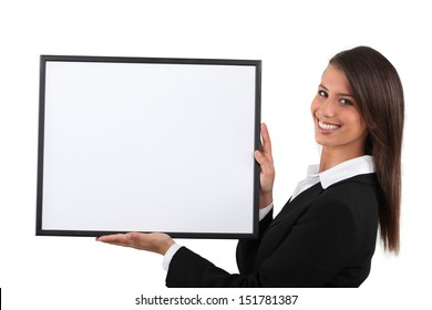 Young woman holding a publicity poster