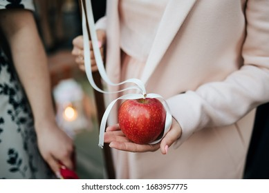 young woman holding red apple