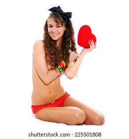 Young woman holding red heart, Valentine day concept, isolated over white