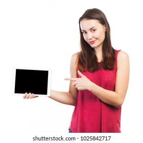 Young woman holding and showing the blank screen of an electronic tablet, isolated on white
