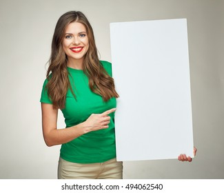 young woman holding  sign business board. isolated portrait of casual dressed woman.