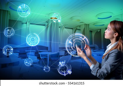 young woman holding smart phone and modern room interior, wireless communication network concept. smart home, smart house.