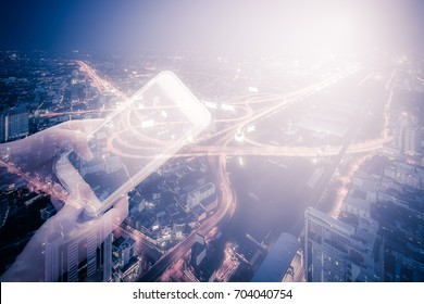 Young woman holding smart phone in hand while typing, double exposure with modern city skyline, vintage style process