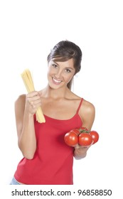 young woman holding spaghetti and tomatoes isolated on white