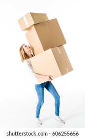 Young woman holding stack of cardboard boxes  isolated on white