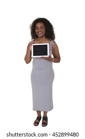 Young woman holding a tablet isolated on white