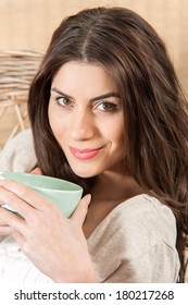 Young woman holding tea close up