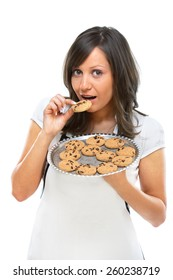 Young woman holding a tray with homemade chocolate cookies, isolated on white
