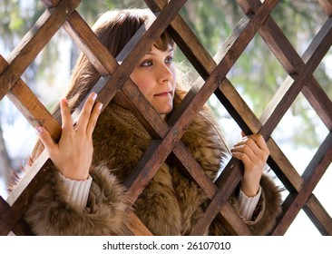young woman holding trellis