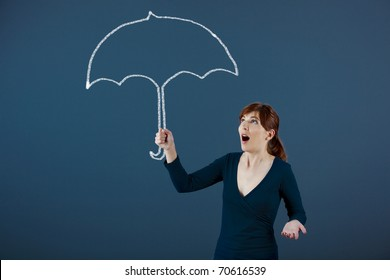 Young woman holding a umbrella drawn with chalk on the wall