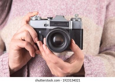 young woman holding the vintage camera.