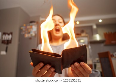 young woman holding a wallet, wallet on fire, surprised girl, magic concept focus, wallet is burning fire