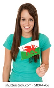 Young woman holding Welsh flag isolated on white