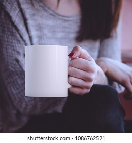 Young woman holding a white mug, perfect for displaying your quote, design on mugs you sell.