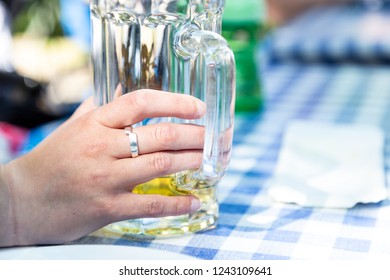 Young woman holds a beer glass in the Hand