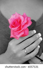 Young Woman Holds Rose Close To Her Heart