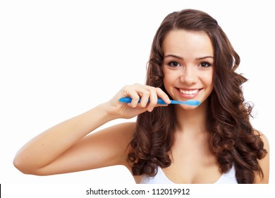 Young woman at home brushing teeth in the morning