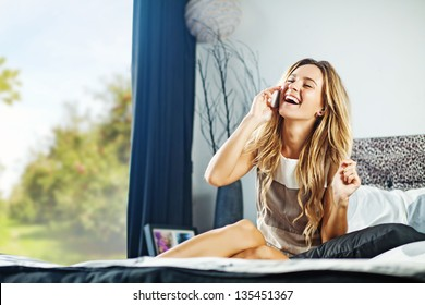 young woman at home with phone