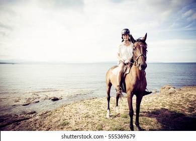 Young Woman Horseback Riding
