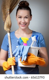 A young woman in a housewife role ready for cleaning.