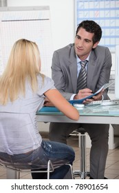 Young woman in interview with trainer