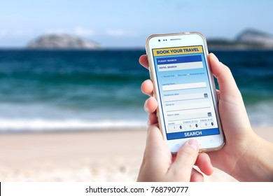 Young woman in Ipanema beach with a smartphone. Tourism booking web page on the screen of this. Young woman. Millennial. Tourism business. Smartphone Application.