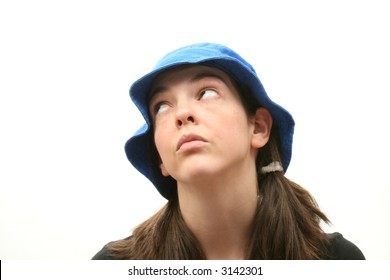 Young woman isolated over white background wearing a hat