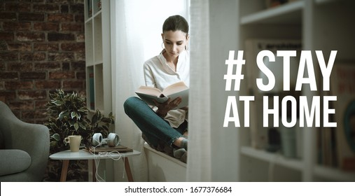 Young woman isolating at home and relaxing, she is reading a book: stay at home social media campaign for coronavirus prevention