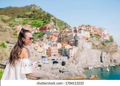 Young woman in italian village on Liguria, Italy