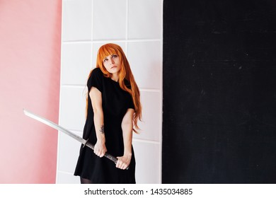 young woman in japanese anime cosplay, holding samurai sword.