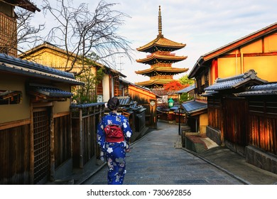 Young woman Japanese Kimono walking Yasaka in street near Pagoda in the Morning, Kyoto, Japan