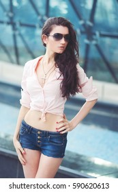 Young woman in jeans short. Fashion