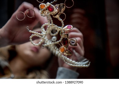 Young woman with jewelry and bijouterie. Low side view
