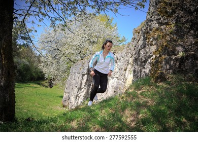 young woman jogging in the mountains