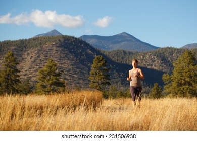 Young Woman Jogging on Beautiful Rural Outdoor Trail