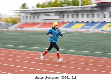 Young woman jogging in the stadium