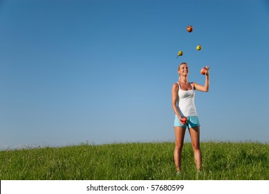 young woman juggling with healthy eating