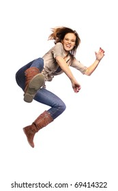 Young woman jump kicking in mid air