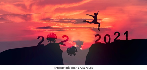 Young woman Jumping across the gap of the mountain from 2020 to 2021 New Year.