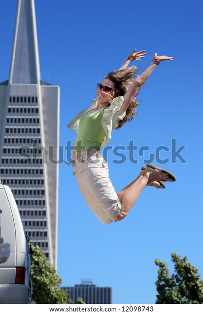 Young woman jumping in downtown San Francisco