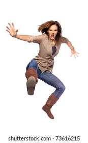 Young woman jumping and kicking